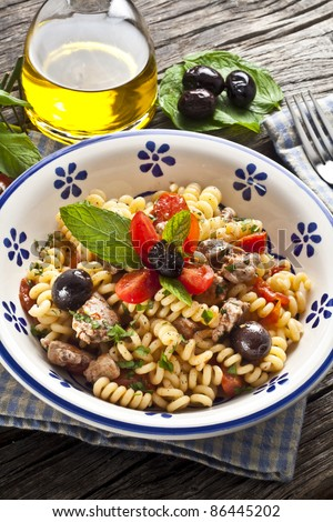 Italian Fusilli pasta with swordfish,olive and raw tomato