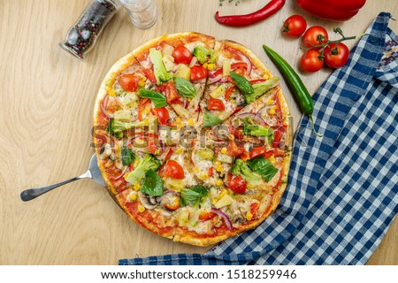 Italian, homemade Italian, homemade vegetarian pizza with mushrooms, onions and broccoli on a wooden table on a wooden table. Top view food with copy space. Flat lay