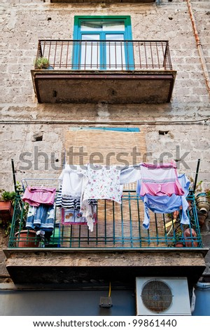 Italian House with laundry hanging in the balcony
