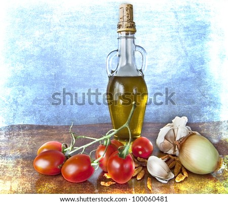 Italian ingredients for a healthy nutrition: olive oil, red and ripe tomatoes, peppers, garlic and onion, on a grunge texture