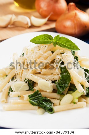 Italian macaroni pasta with chad or silverbeet and grated cheese