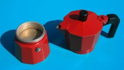 italian moka pot coffee maker isolated on blue background