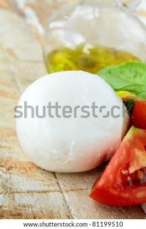 Italian mozzarella cheese with tomato and basil