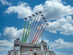 Italian National Republic day Air show aerobatic team frecce tricolore flying over altare della patria in Rome, Italy