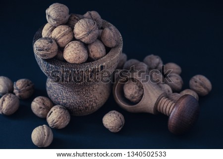 Italian nuts. Wooden nutcracker. Scattered nuts on a table with shallow depth of depth and depth. #1340502533
