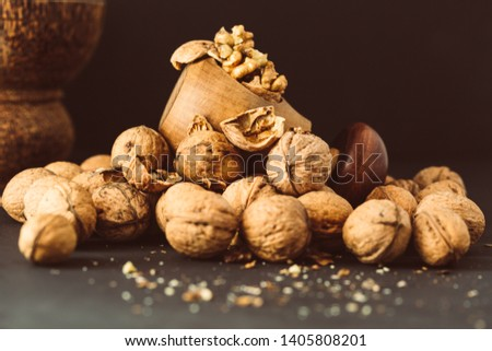 Italian nuts. Wooden nutcracker. Scattered nuts on a table with shallow depth of depth and depth. #1405808201