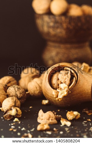 Italian nuts. Wooden nutcracker. Scattered nuts on a table with shallow depth of depth and depth. #1405808204