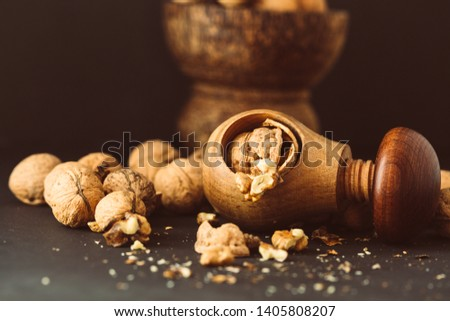 Italian nuts. Wooden nutcracker. Scattered nuts on a table with shallow depth of depth and depth. #1405808207