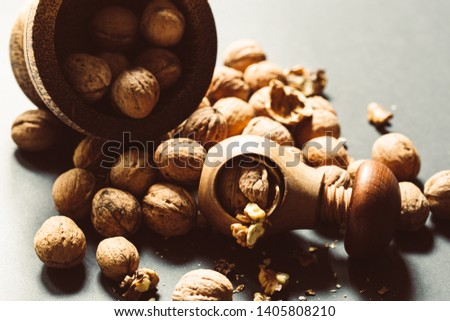 Italian nuts. Wooden nutcracker. Scattered nuts on a table with shallow depth of depth and depth. #1405808210