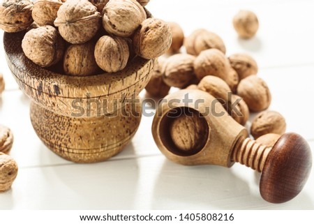 Italian nuts. Wooden nutcracker. Scattered nuts on a table with shallow depth of depth and depth. #1405808216