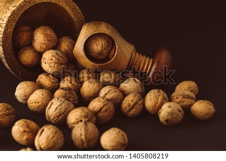 Italian nuts. Wooden nutcracker. Scattered nuts on a table with shallow depth of depth and depth. #1405808219