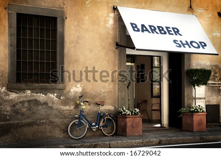 Italian old style bicycle outside a barber shop