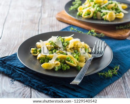 Italian orecchiette pasta with peas, cream and pecorino cheese #1229540542