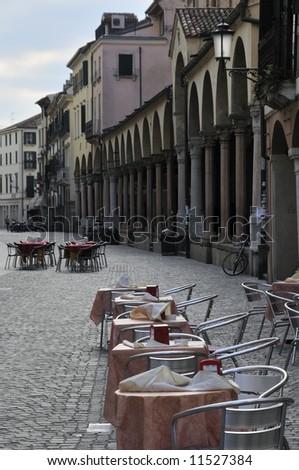 Italian outdoor cafe on a main street of Padova