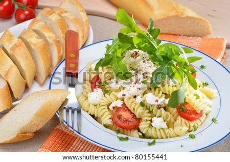 Italian pasta salad with ricotta and rucola