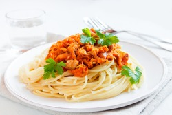 Italian pasta - Spaghetti with meat and vegetable sauce on plate close up