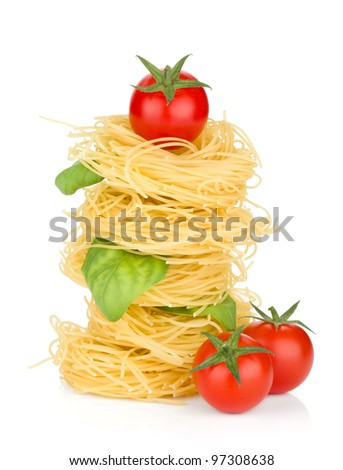 Italian pasta, tomatoes and basil. Isolated on white background