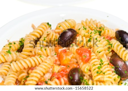 Italian Pasta with cheese, fresh tomatoes and olives.