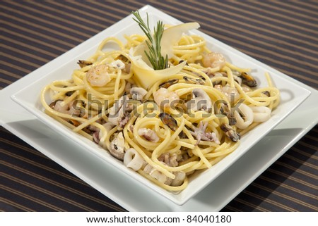 Italian pasta with seafood and rosemary