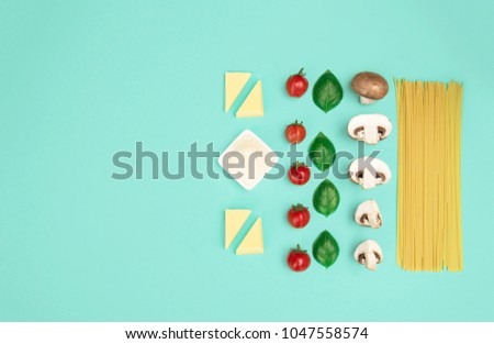 Italian pasta with tomatoes, grated parmesan and basil. Flat lay style, knolling concept with copy space. - Shutterstock ID 1047558574