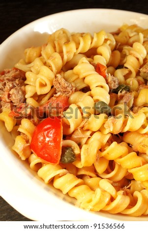 Italian pasta with tuna, fresh cherry tomatoes and capers