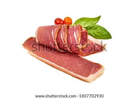 Italian prosciutto crudo or spanish jamon. Jerked ham, isolated on white background. Stock photo ©