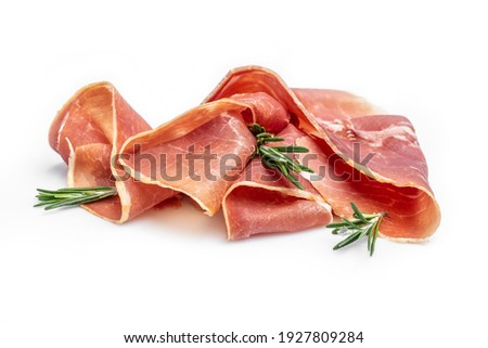 Italian prosciutto crudo or spanish jamonwith rosemary, raw ham leg sliced isolated on white background. Foto stock ©