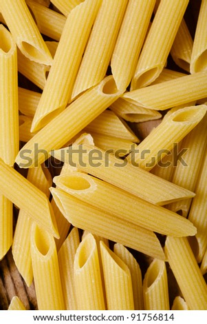 Italian raw pasta - penne background closeup