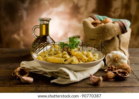 Italian regional dish made of pasta with walnut pesto on wooden table