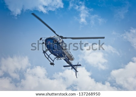 italian rescue helicopter flying for an emergency on blue sky