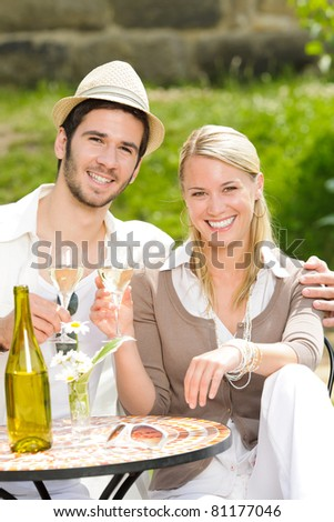 Italian restaurant terrace, an elegant couple celebrate