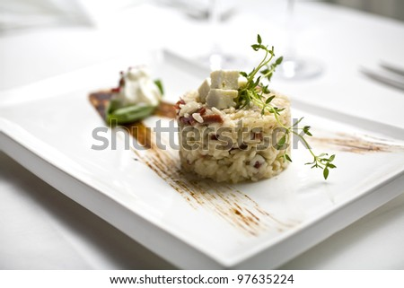Italian risotto serving on restaurant table, risotto