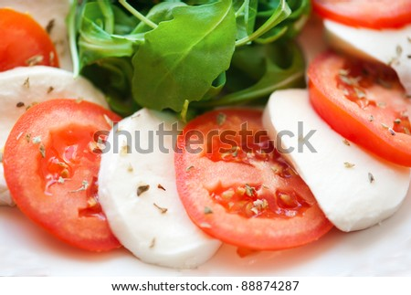 Italian salad with tomatoes and mozzarella filmed in close-up