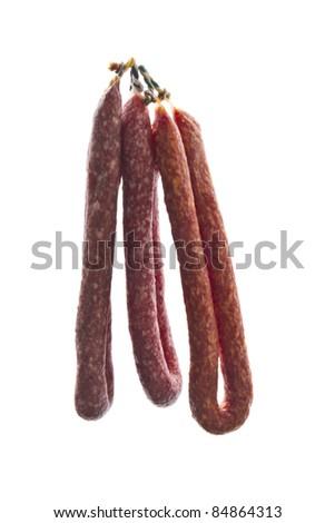 Italian salami sausages closeup on white background