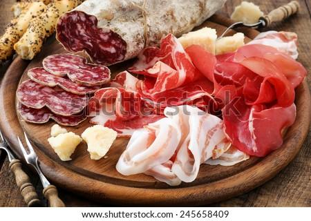 Italian salumi meat platter - prosciutto ham, bresaola, pancetta, salami and parmesan