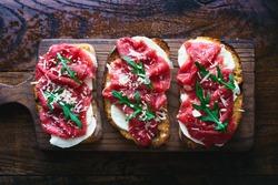 Italian sandwiches with mozzarella and beef carpaccio top view
