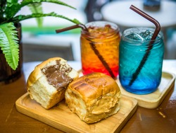 Italian soda and bread stuffed with chocolate. sweet with soda on the table.