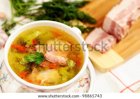 Italian soup with vegetables and bacon - stock photo