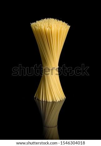 Italian spaghetti, elegant pic taken on a black background.