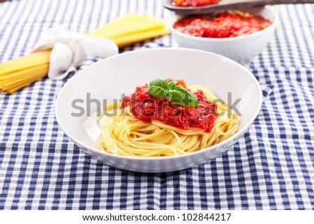 Italian Spaghetti with tomato sauce on traditional home towel