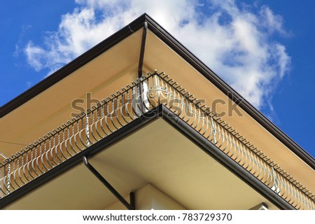 Italian Style Balcony with Hand Rails of high-grade Steel in Front of a modern Building