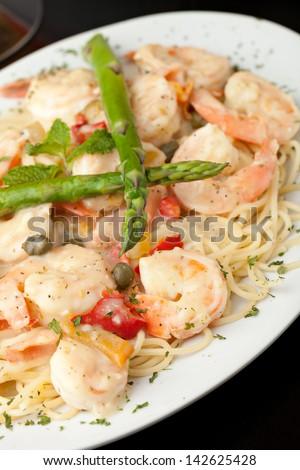 Italian style shrimp scampi pasta dish with spaghetti.