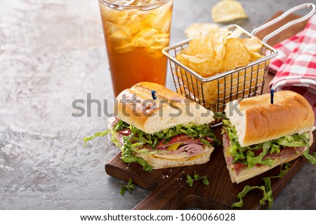 Italian sub sandwich with salami, ham and chips with copy space #1060066028