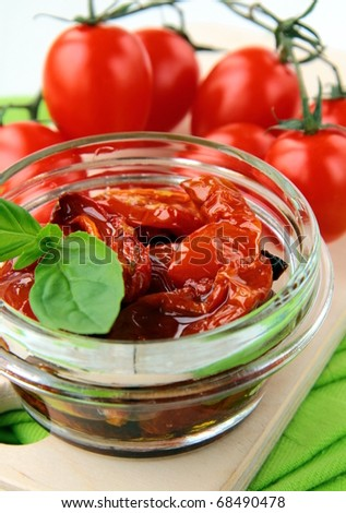 Italian sun dried tomatoes in olive oil, glass jar