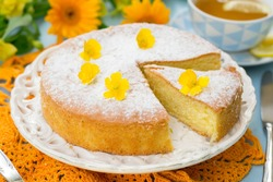 Italian sweet cake Torta Margherita with icing sugar with tea