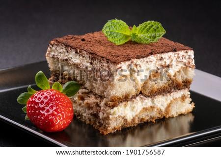 italian tiramisu with cocoa, mint and  strawberry Photo stock ©
