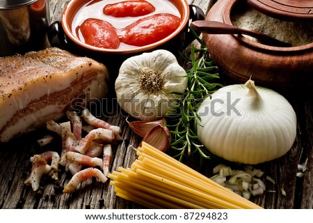 italian traditional pasta amatriciana ingredients on wood