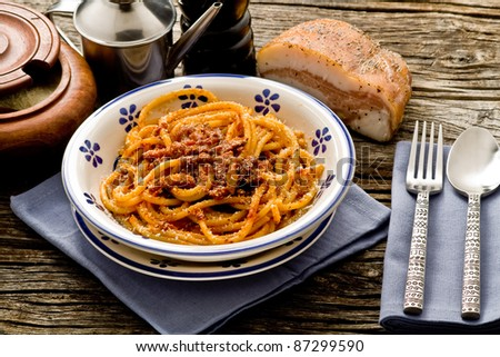italian traditional pasta amatriciana served ona table wood