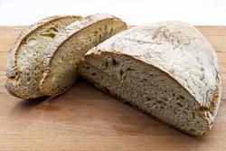 Italian Tuscan Bread on wooden cutting board.