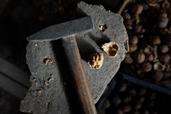Italian walnut cracked by hammer, still life image composition